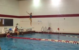 Junior Jackie Olson dives during practice