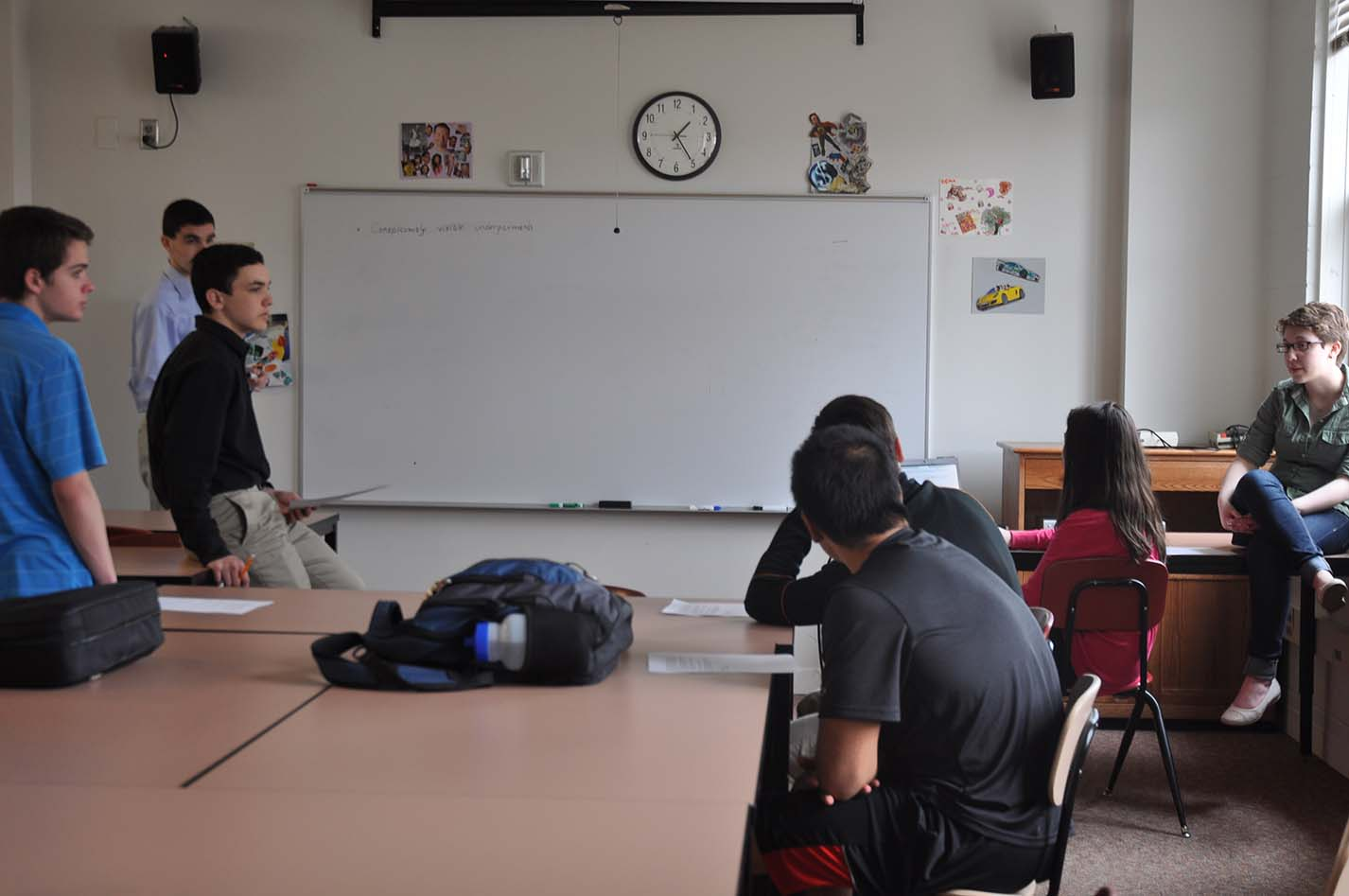 "Upper School Council discusses dress code revisions at their meeting during Tutorial on May 16.  ""We are tentatively taking out offensive language and subjective rules,""  former USC Secretary Cait Gibbons said."