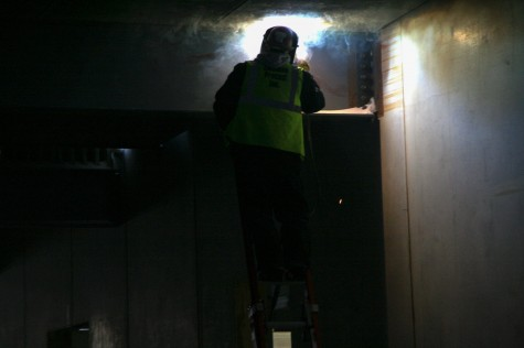 """""""When he welds, don't look right into the blue flash,"""" architect Benjamin Freyinger warned. Construction will continue through the cold despite most construction conventionally ending around Thanksgiving. """"It's the only way to beat the schedule,"""" Mahanna said."""