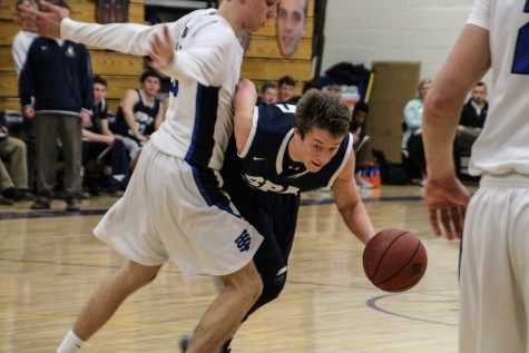 Boys' Varsity Basketball loses close match against STA