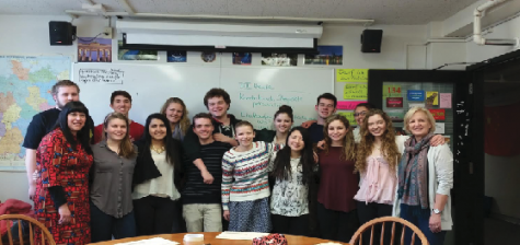 """Students going on the German Exchange pose for a photo during one of the tutorial sessions that were held for students to learn more about the trip. """"The most important thing for me is that I will end the trip with improved German speaking skills,"""" senior Luke Bishop said."""
