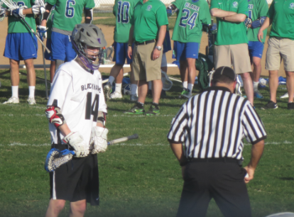 """Junior David Nicholson prepares for the face off at the April 17 game against Blake. """"[Creating a team] was a step in the right direction for the schools,"""" Nicholson said."""