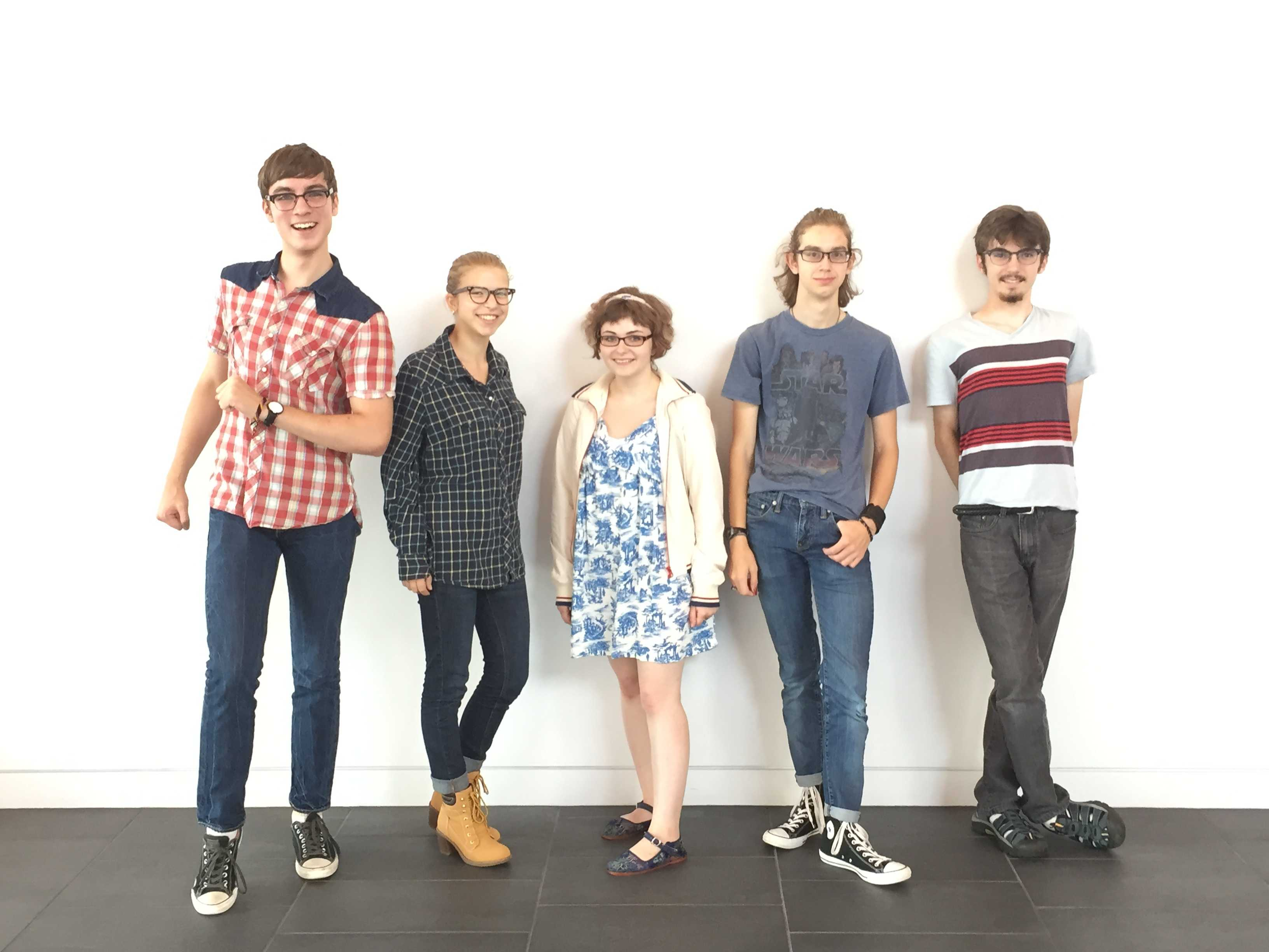 Theater students get excited about performing in the new Huss Center. From left to right: junior Kyle Ziemer, senior Maren Findlay, juniors Phoebe Pannier, Andrew Michel, and Cole Thompson.