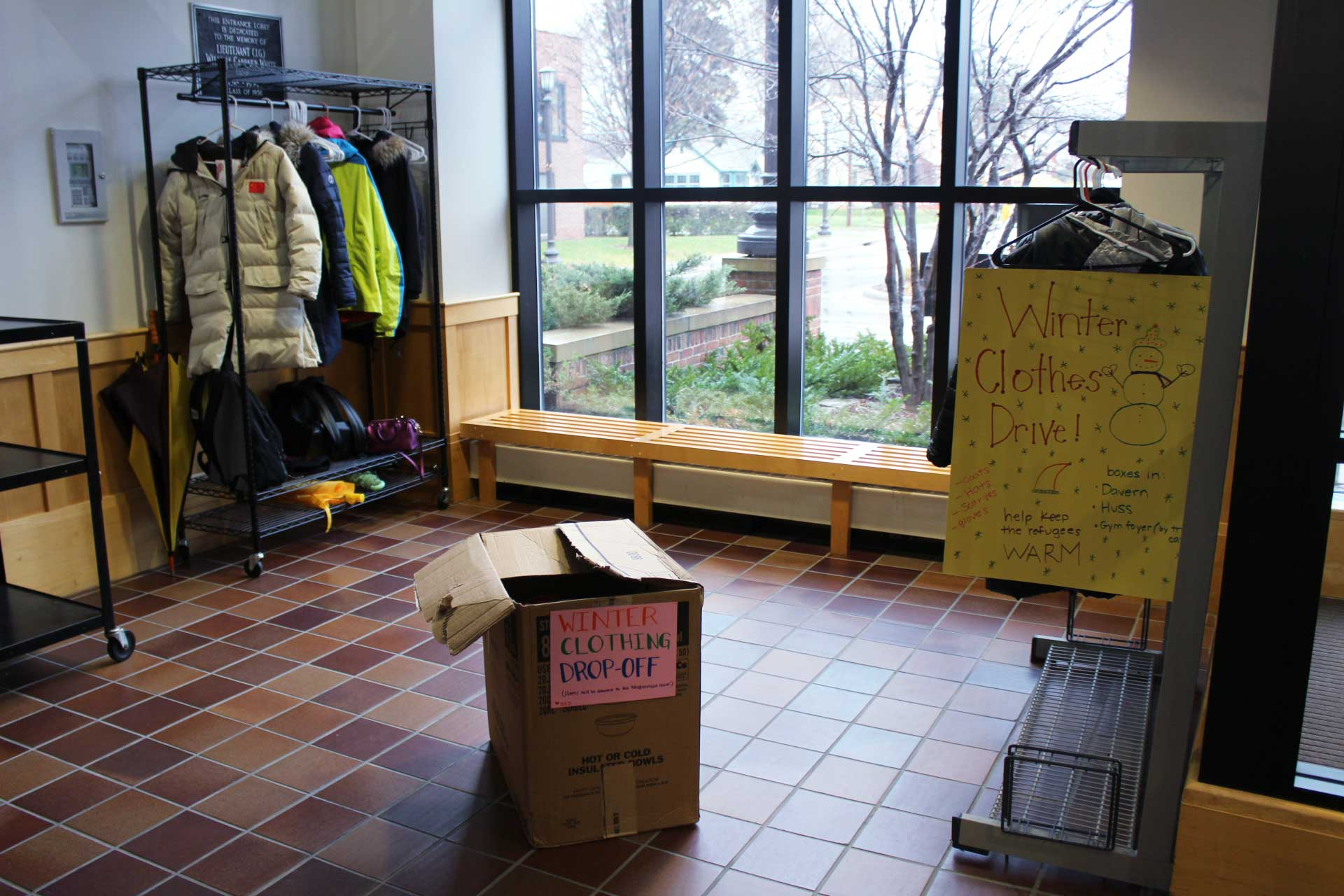 """Students for Social Justice set up boxes and racks in different parts of the school for students to drop off gently used winter clothing. Sophomore Emilia Hoppe, a member of SSJ, said """"all of the clothing that we collect is going to go to the Neighborhood House, which is a place that among other things, helps out refugees."""""""
