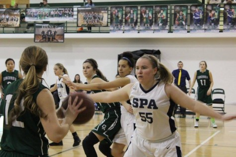 Girls Basketball team hypes up with music, plays for the team