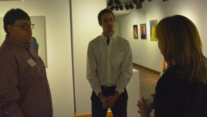 Dowdle+and+Smith+talk+to+their+former+art+teacher+Joy+Liberman+at+the+opening+show.