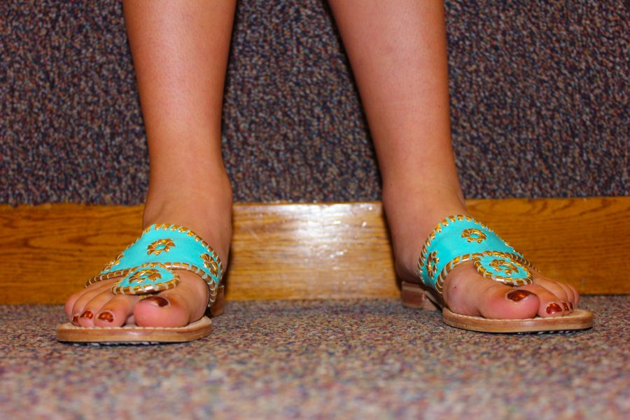 Senior+Kathryn+Schmechel%27s+bright+shoes+warrant+a+close+up.+