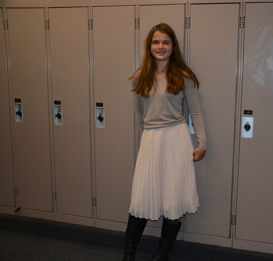 Junior+Emilia+Topp-Johnson+pairs+a+flowy%2C+pleated+skirt+with+a+neutral+sweater.+