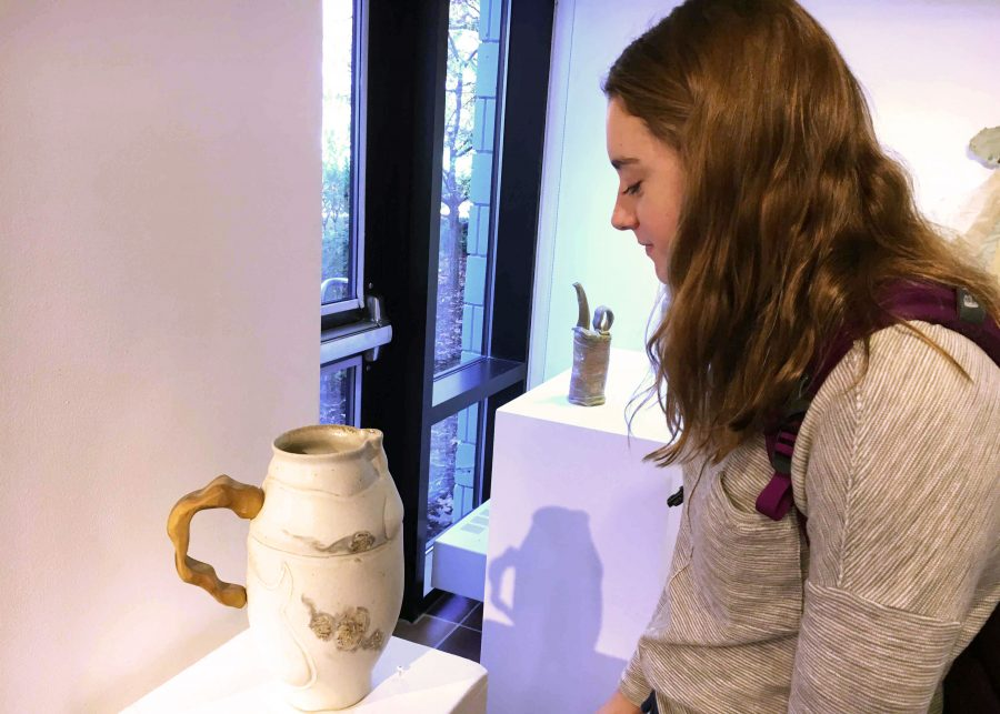 Ceramics+student+and+sophomore+Janie+Brunell+admires+the+ceramic+pieces+in+the+Harry+M.+Drake+Gallery.+%22I+can+tell+that+%5Bin+this+piece+there+are%5D+a+couple+parts+that+were+done+on+the+wheel%2C+but+the+handle+had+to+be+sculpted+or+carved.+It%27s+cool+that+they+incorporated+a+bunch+of+techniques+to+make+a+piece%2C%22+Brunell+said+while+looking+at+a+vase.