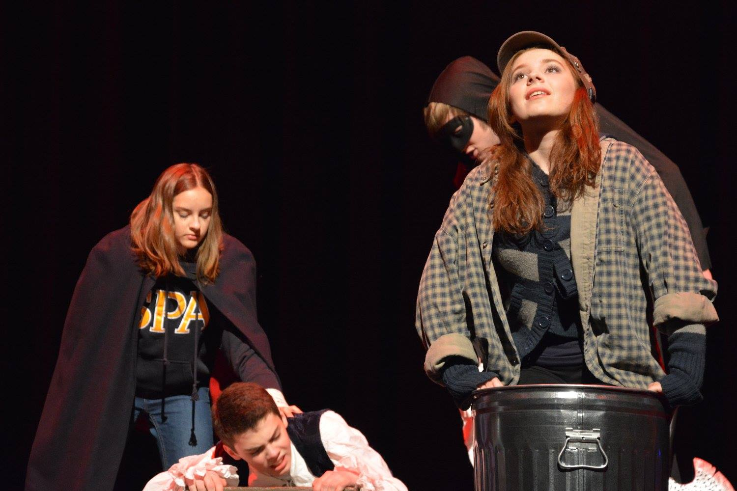 Junior+Tess+Hick+feeds+9th+grader+Henry+Vliestra+his+line+as+his+character+desperately+does+not+know+how+he+found+himself+stuck+inside+a+play.+Senior+Bailey+Troth+and+sophomore+Chloe+Morse+both+portray+actors+in+this+Shakespeare+spoof.+