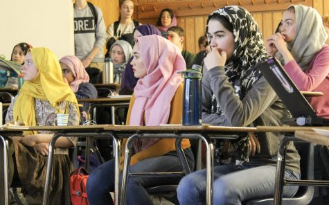 Community invited to wear a green ribbon or a hijab in solidarity