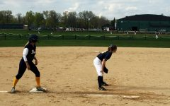 Softball wins a high scoring game against rival Breck