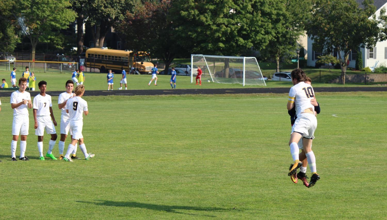Junior+Captain+Michael+Forsgren+runs+onto+the+field+at+the+start+of+the+game.