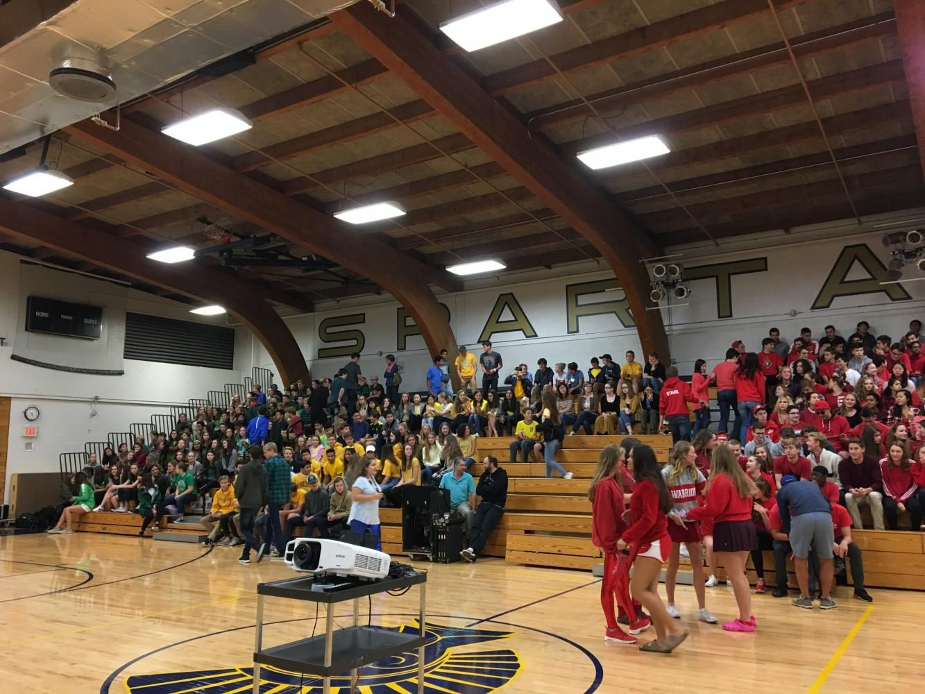 Students+arrange+themselves+by+grade+%28and+class+color%29+for+the+kick-off+assembly.+%22It+was+good+to+show+school+spirit+for+the+upcoming+homecoming+week.+It+was+enjoyable+because+it+was+quick+and+focused+on+just+our+school%2C%22+sophomore+Fremont+Forsberg+said.+