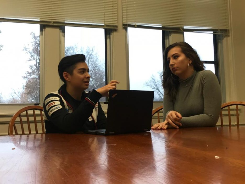 """Seniors Aaron Datta and Sylvie Schifsky work together on an upcoming English presentation about using feminist and queer theory to analyze text. """"I can try to teach others about the gender-queer experience, but it also means that I have to understand that all of my actions re ect a bunch of other people now,"""" Datta said."""
