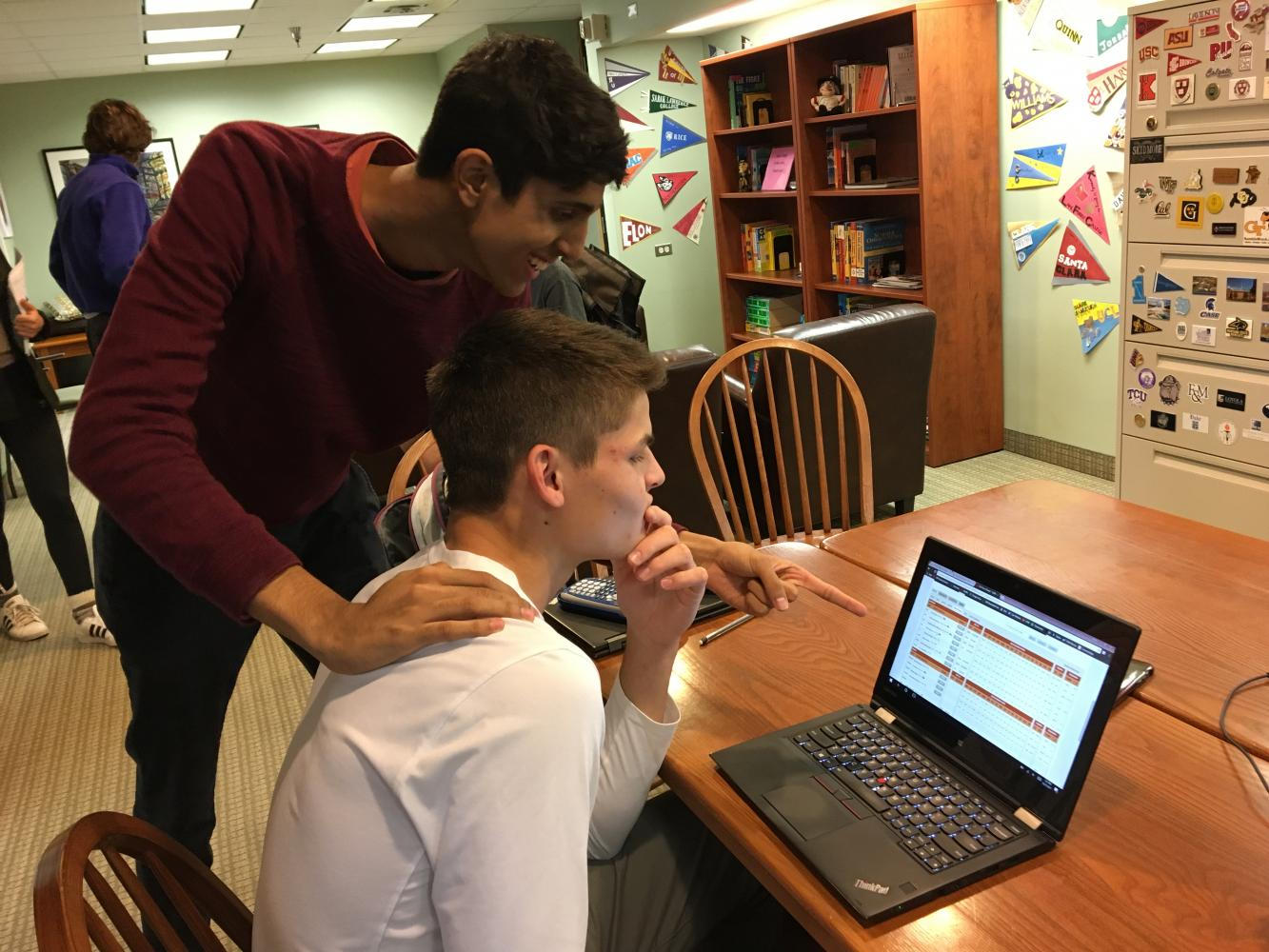 "Seniors Rahul Dev and Gus Grunau study Grunau's fantasy basketball team's points for the week. ""People say my team is bad when they hear the names. They aren't big names, but on paper and with my managerial skills, I am feeling confident for this season,"" Grunau said."