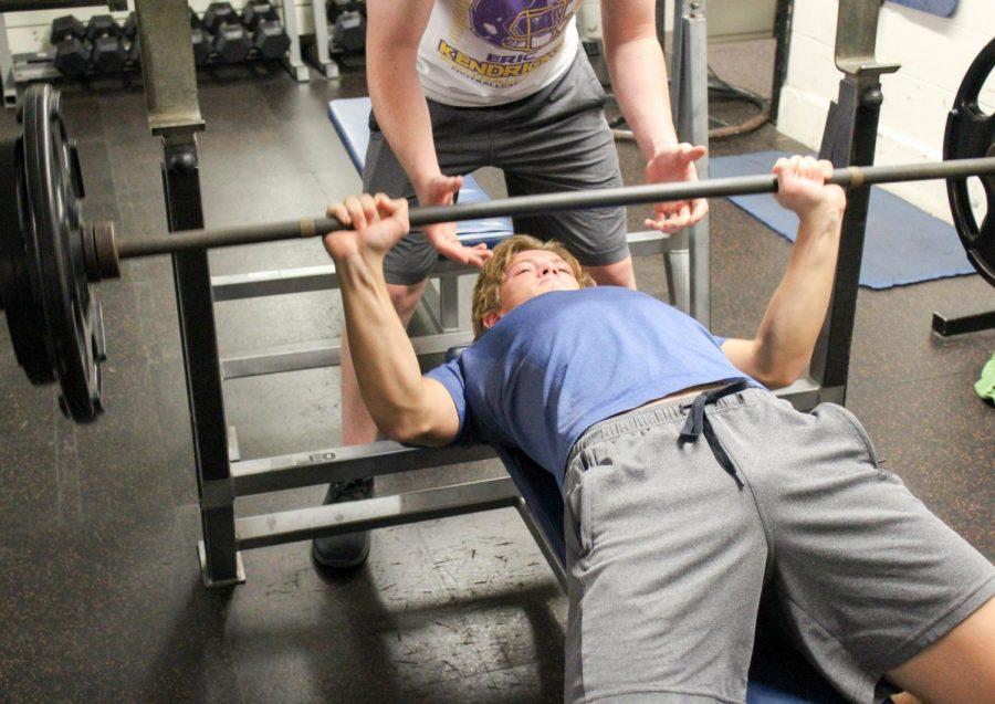 Junior+Adam+Zukowski+lifts+in+the+weight+room.