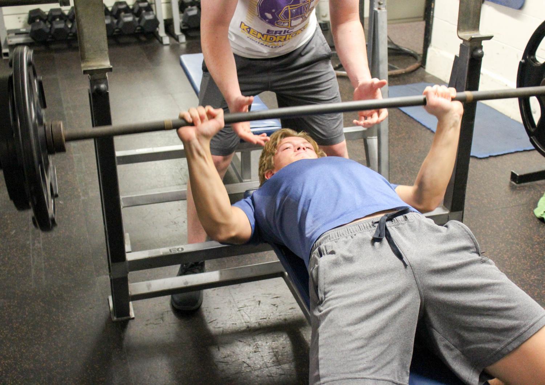 Junior Adam Zukowski lifts in the weight room.