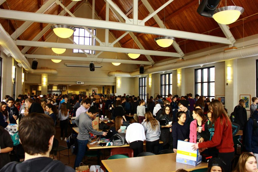 Students+and+faculty+gathered+in+the+lunch+room+to+wrap+gifts+and+hear+an+acapella+performance+of+%22Silent+Night.%22+