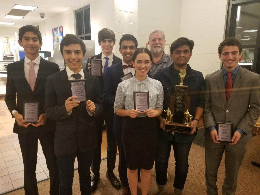 National+Qualifiers+pose+with+their+plaques+and+their+coach+at+the+Dec.+9+tournament.