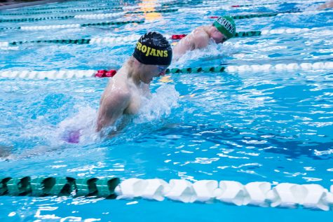 Trojans fight hard during swim meet, take third place