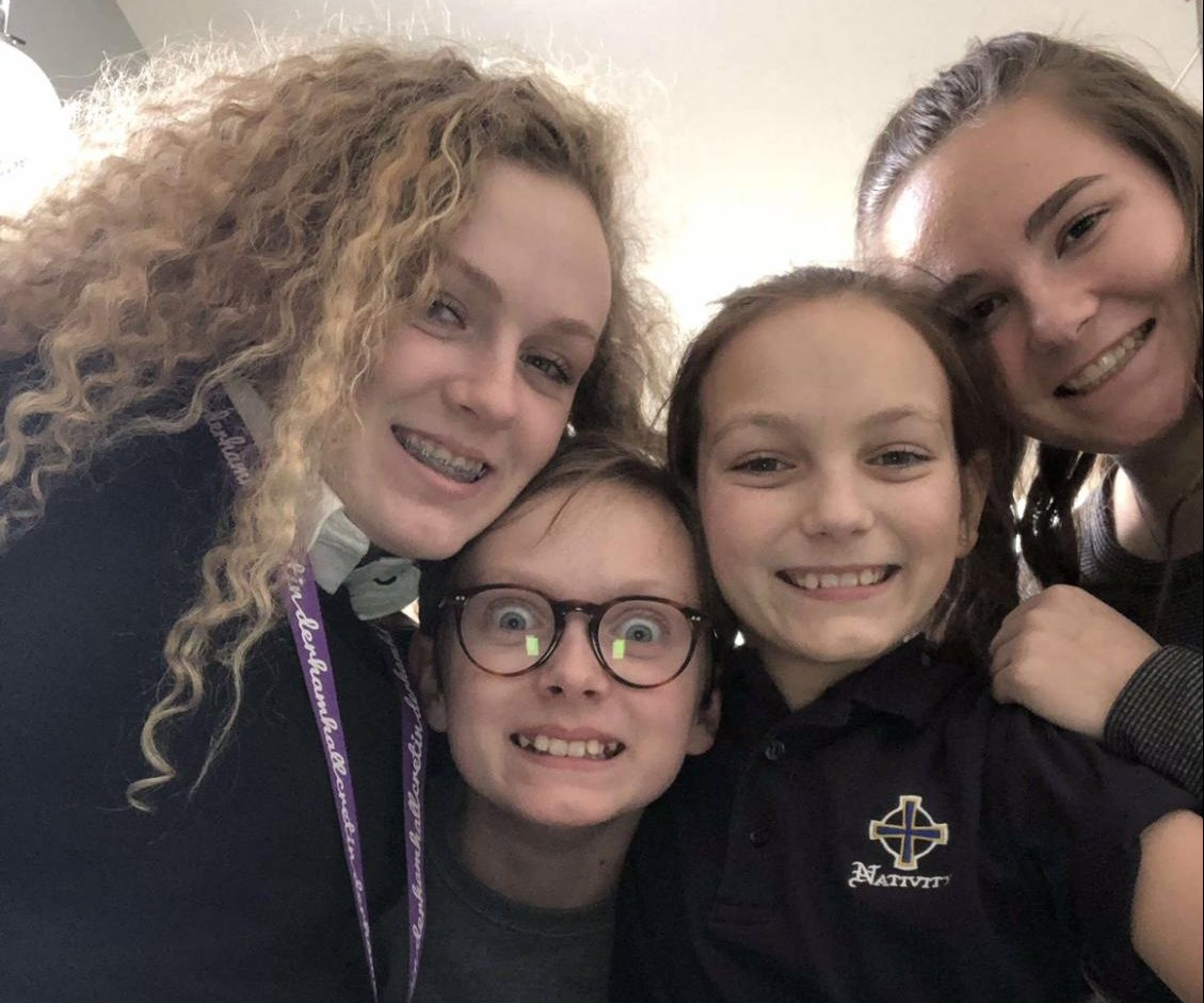 """Senior Libby Woodson and the children she nannies goofing off and having a good time. """"I would totally recommend it if you like kids because it's super easy, and kids are cute,"""" Woodson said."""