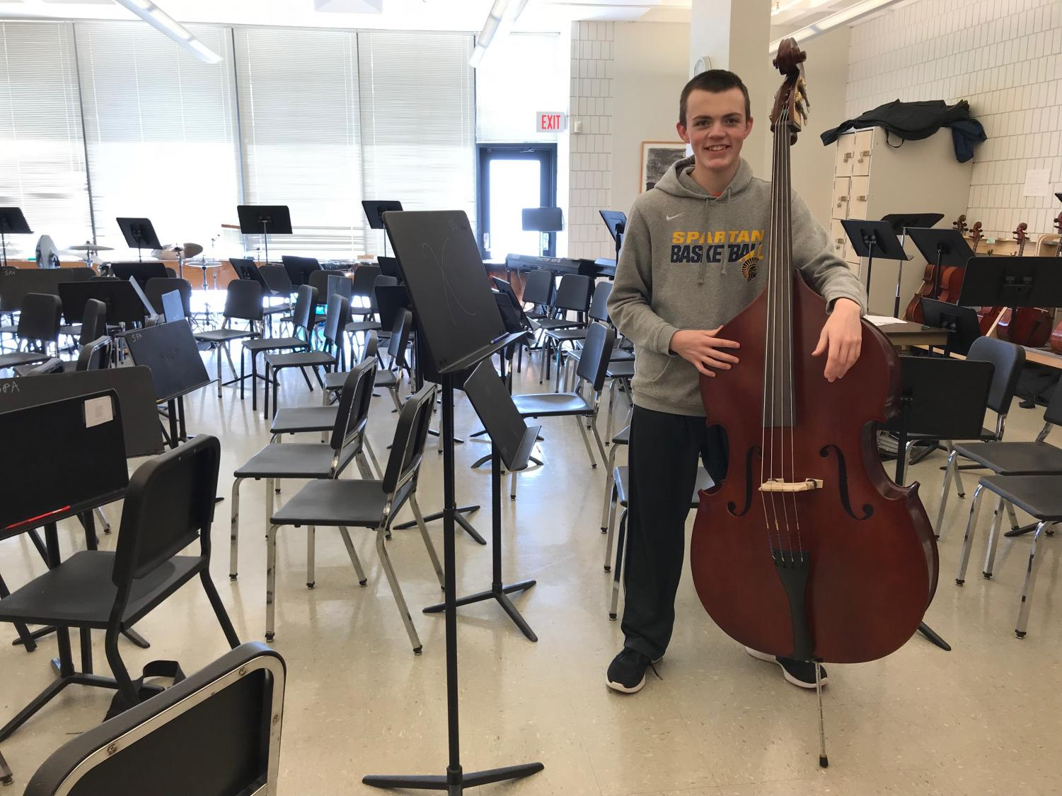 "ALL-STATE BASS. Sophomore Zach Dyar takes on new challenges with his acceptance to the All-State orchestra, ""The learning experience was quite different than what I'm used to, grinding out all the pieces in a week long camp,"" Dyar said."