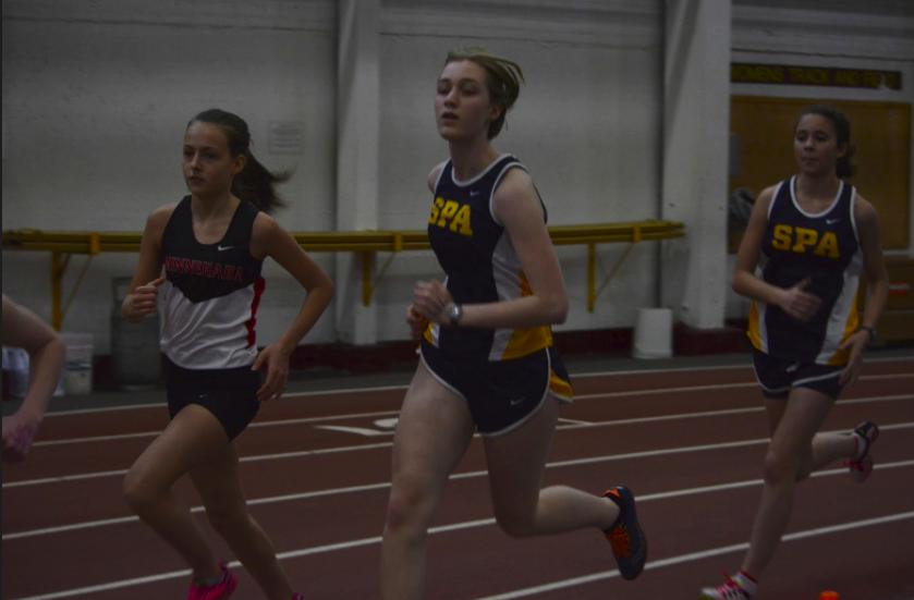 Junior+Maggie+Hlavka+and+7th+grader+Becca+Richman+run+long+distance.+