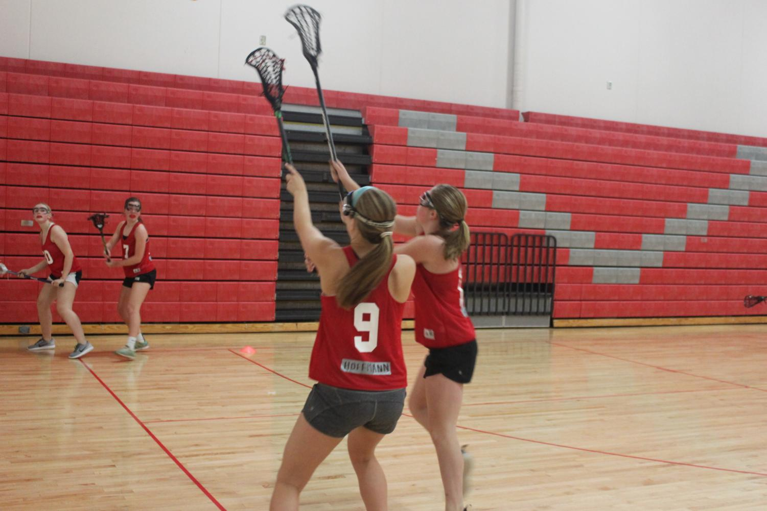 Hayley Hoffman and Erin Magnuson fight for the ball.