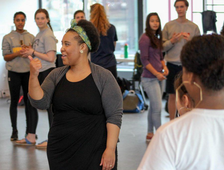 Aja+Parham+begins+her+demonstration+on+how+to+salsa.+