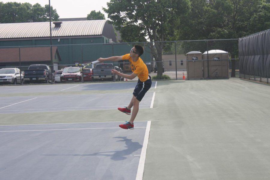Junior+Jeffrey+Huang+swings+through+a+powerful+serve.