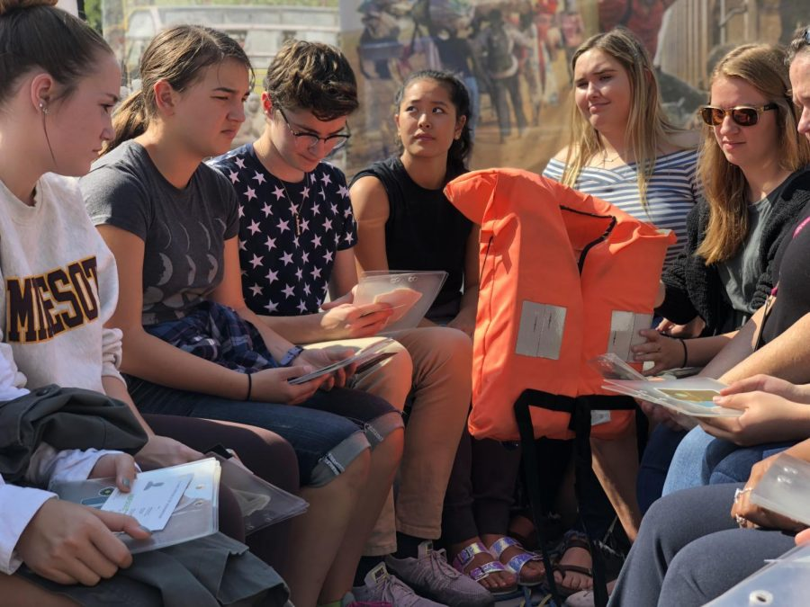 Students engage with interactive global refugee exhibit