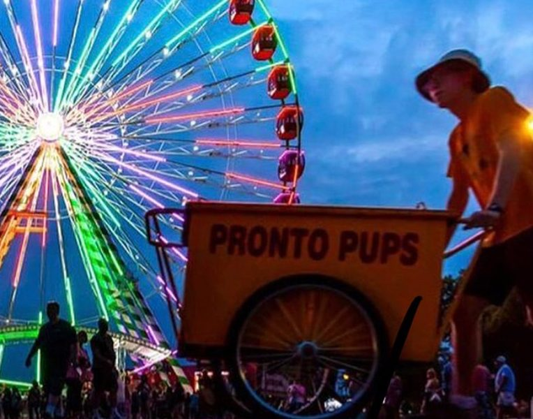 Senior Will Swanson pushes the Pronto Pup cart to and from the ends of the fair.