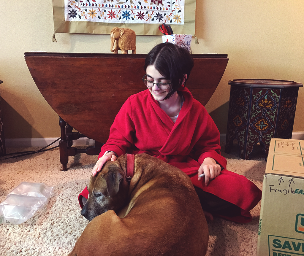 "Junior Savita Yopp pets her dog, Lily. ""Lily is such a lemon. Anything and everything will make her sick. It is ridiculous. I totally love her though,"" Yopp says."