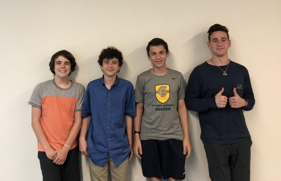 Senior+Reuben+Vizelman+and+his+mentees%2C+9th+graders+Nathan+Mann%2C+Griffin+Moore%2C+and+Alexander+Moore%2C+pose+for+a+photo.