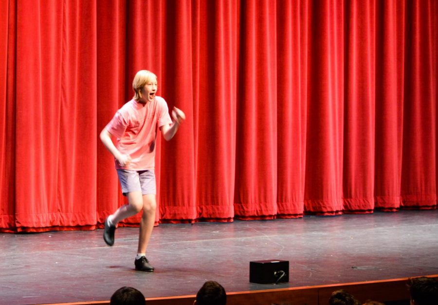 Sophomore+Rylan+Hefner+tap+dances+in+front+of+the+upper+school+while+lip+syncing.