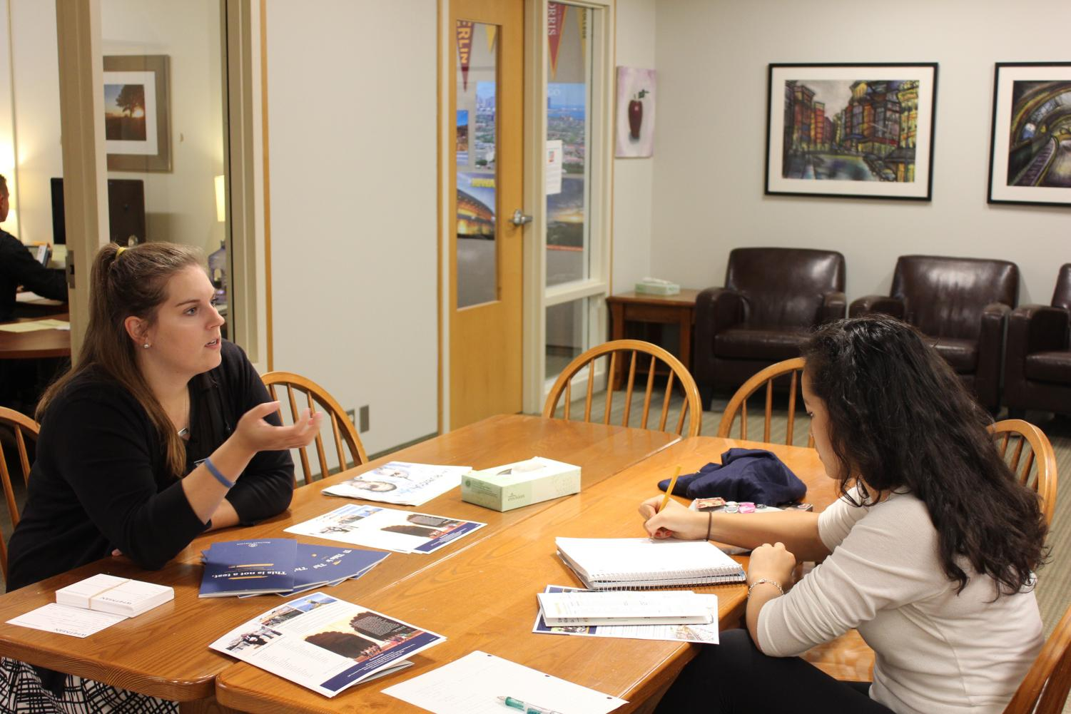 "Assistant Director of Admissions at Whitman College Madison Hollenbeck talks to senior Elea Besse at a college visit. ""A visit really helps pull back the curtain,"" Hollenbeck said."