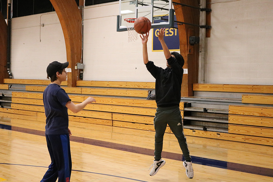 PLAY members shoot baskets in the gym.