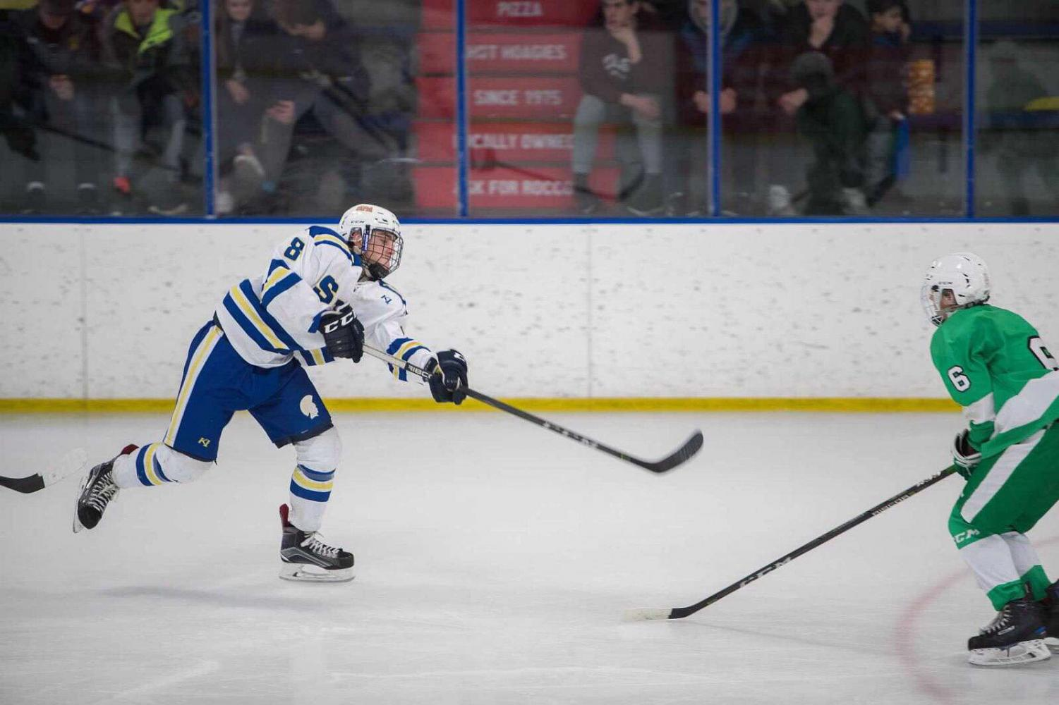 Sophomore Michael Bagnoli shoots the puck. Bagnoli is a two sport varsity athlete playing soccer and hockey.