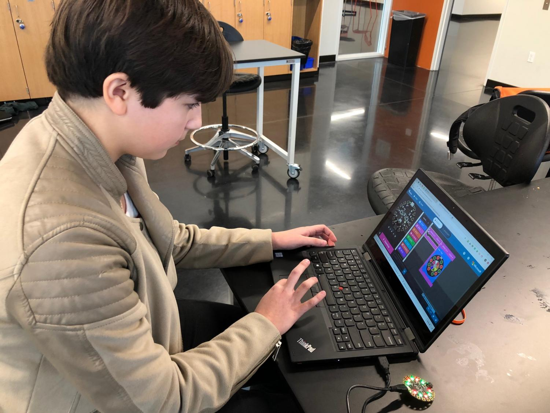 Ninth grader Graciela  Whitaker-Castaneda practices her block coding skills during hour of code.