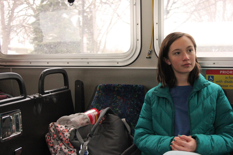 Ninth grader Olivia Szaj sits on her bus ride home.
