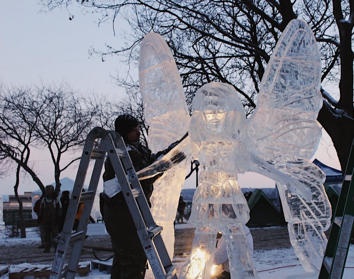 Ice sculptors work on their pieces during the carnival, allowing anyone to watch the progress of the sculpting.