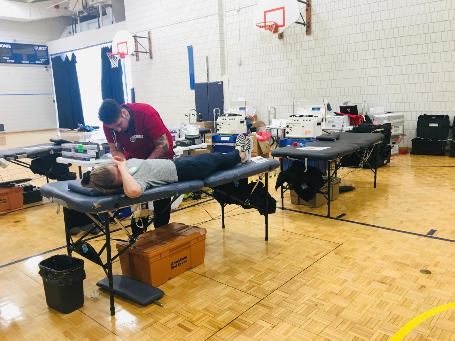 Students getting their blood drawn in the small gym
