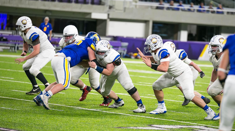 Senior Riley Tietel blocks a member of the opposing defensive line.