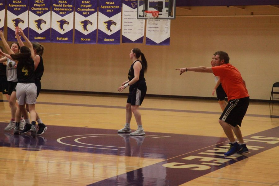 Head+girls+varsity+basketball+coach+Nick+Novak+instructs+players+through+a+drill