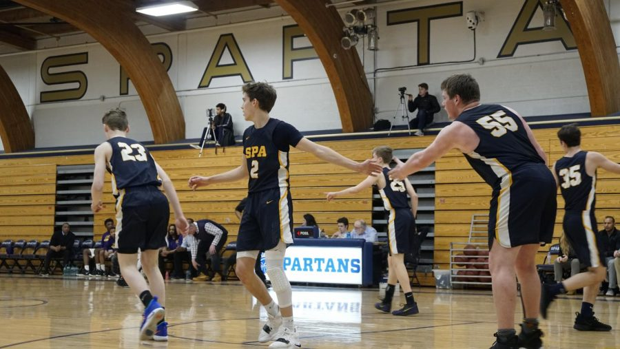 Boys' Varsity Basketball advances to section quarterfinal