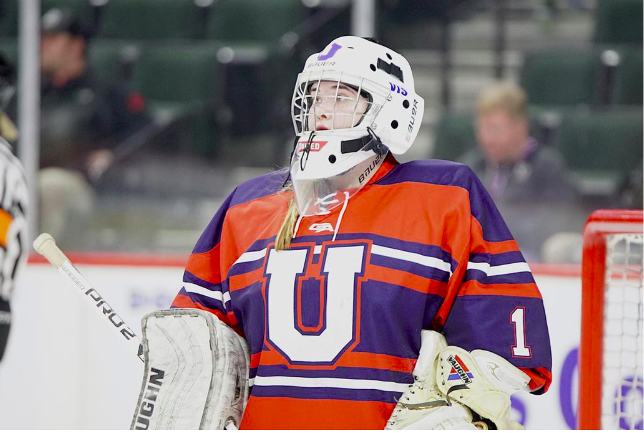 Geise stands in net during the quarterfinal round of the 2019 state tournament at the Xcel Energy Center.