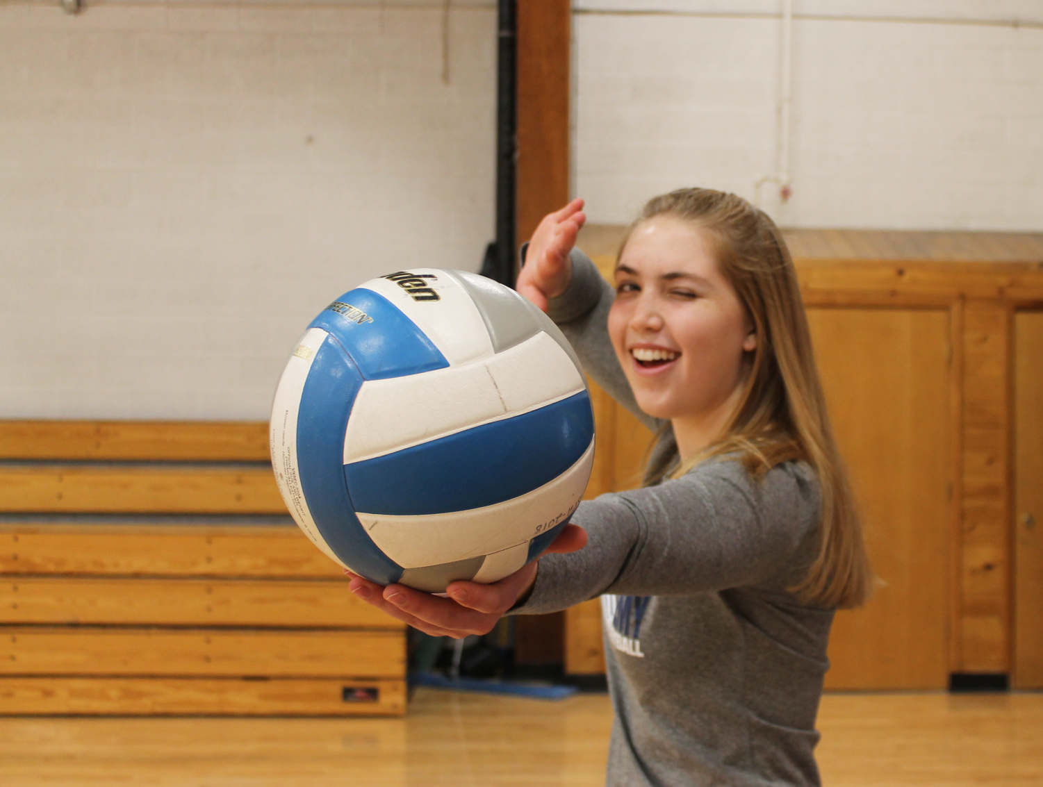 Junior Sydney Therien winks every time she serves in volleyball as a special good luck charm.
