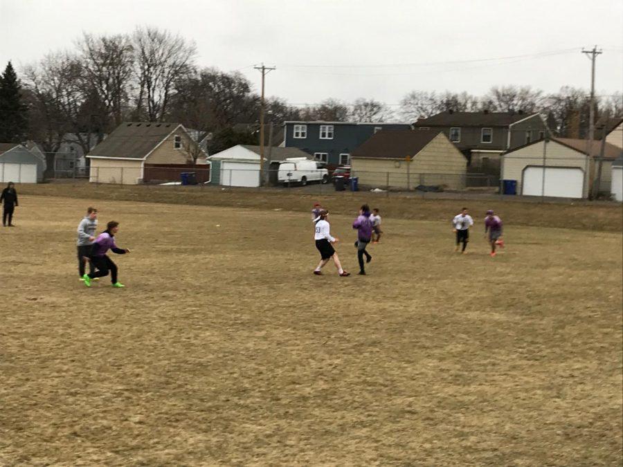 Senior+Matt+Pauley+runs+to+catch+a+pass.