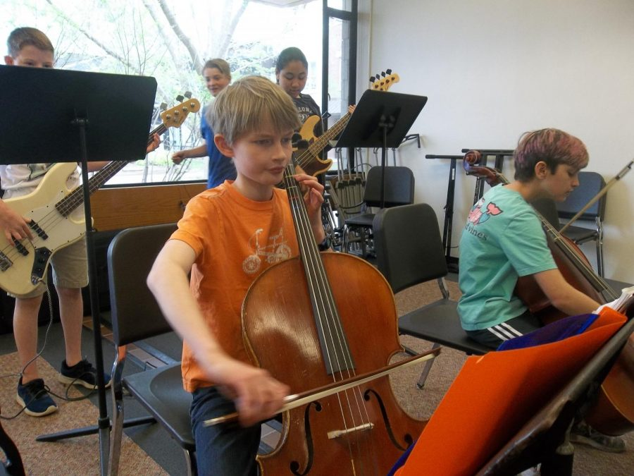 Ben+Lorenz-Meyer+and+Bobby+Peres+are+tuning+their+cellos+and+practicing+Don%27t+Stop+Believin%27+before+class+starts.